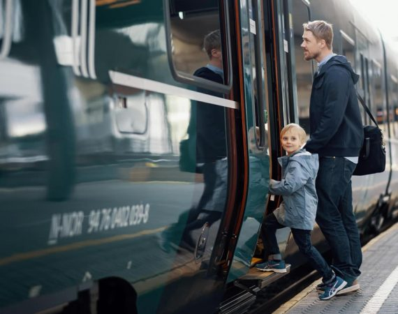 Vy case study image of child and man getting on train